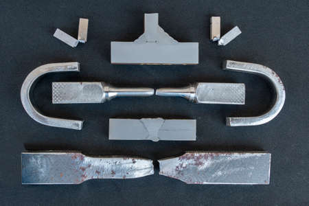 Steel from destructive testing (DT) is Bending test, Macro test, Tensile test and Impact test, on black background.