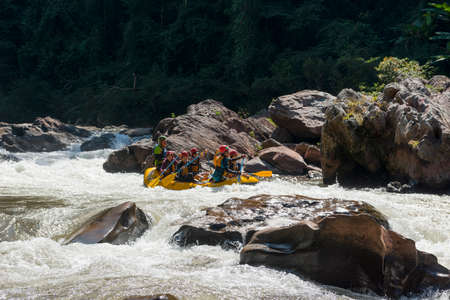 NAN, THAILAND on November 15,2019 : White water rafting on the rapids of river mam va in NAN, Thailand. Mam Va river is one of the most dangerous rivers of Thailand.