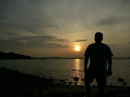 man: Man looking at sunset Stock Photo
