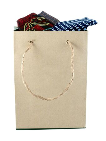 Necktie in a shopping bag made from brown recycled paper photo