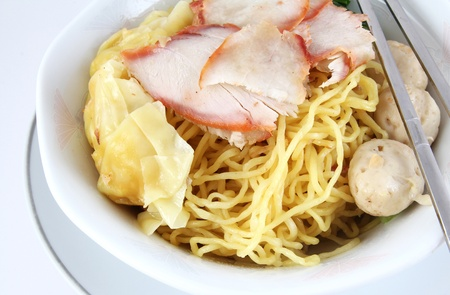 Thai dry noodles with roast red pork and chopsticks  Stock Photo - 10505303