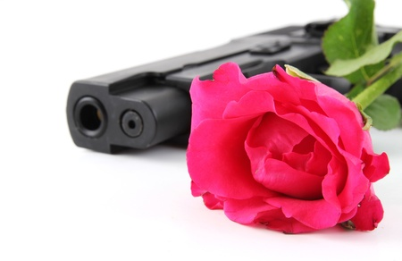 Red rose and black pistol on white background  Stock Photo