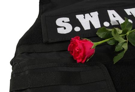 Red rose on bulletproof vest isolated and white background Stock Photo