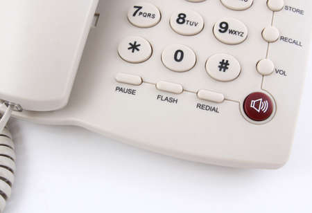 landlines: Closeup of a white office telephone on white background