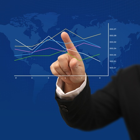 Businessman hand point to highest target on graph with blue background