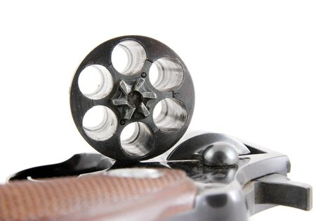Closeup image of open cylinder of revolver on white background
