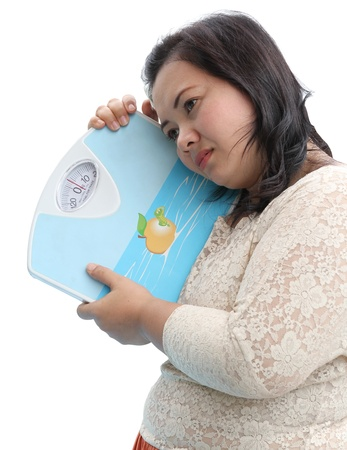 Image of fat woman holding and hug weight scale