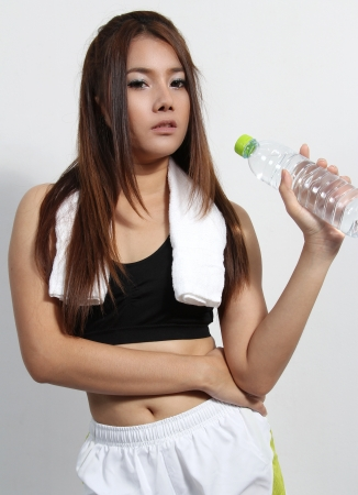 Tired Workout college woman and holding fresh water