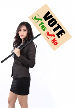 woman holding vote sign to calling people goto vote Stock Photo
