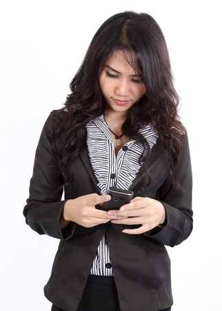 Business woman standing and search a number on her hand