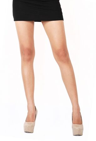 Image of business woman leg standing on white background
