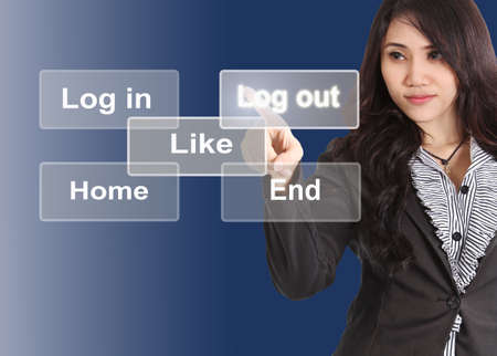 log out: Business woman push her finger log out button on touchscreen Stock Photo