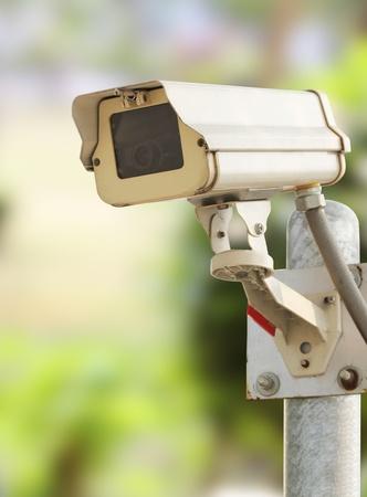 Closeup image of CCTV security camera at garden outdoor
