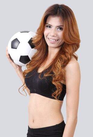 Image of asian woman holding a football on right hand Stock Photo - 18212456