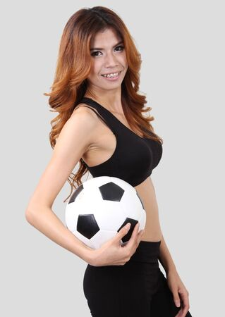 Image of woman holding a football on right hand and white background Stock Photo - 18212437