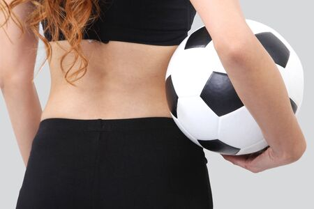 Image of woman holding a football on her hand and white background photo