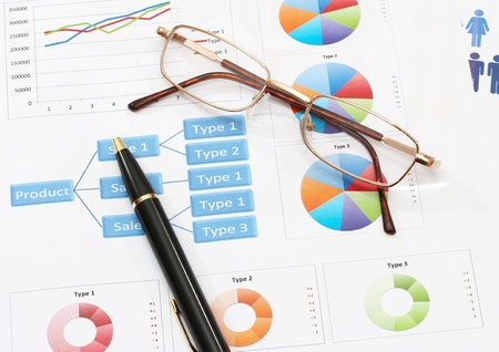 image of infographics for business report with pen and glasses