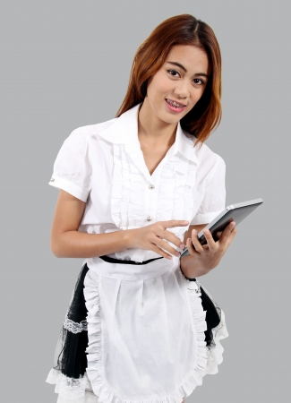 Image of asian young waitress in white blouse and hold tablet in her hand