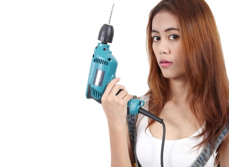 Image of woman worker holding drill in hand for her job photo