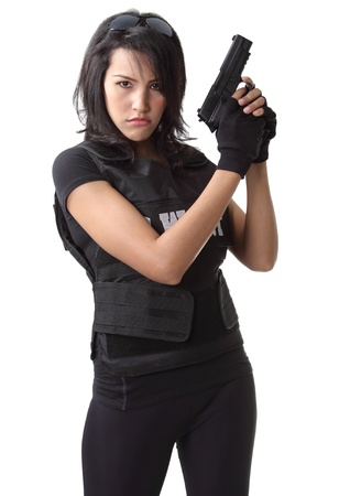 asian woman wearing swat bulletproof vest and holding a gun on her hand Stock Photo - 20547449