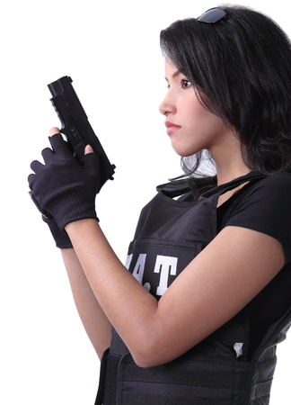 asian woman wearing swat bulletproof vest and holding a gun on her hand