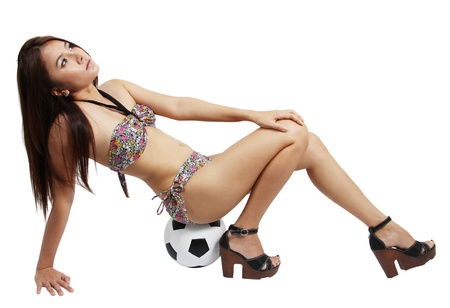 Image of asian young woman in sexy bikini sitting on her football  Stock Photo - 20629107
