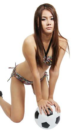 Image of asian young woman in sexy bikini touch her football