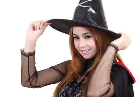 Image of portrait asian woman in black hat and black clothing on halloween Stock Photo