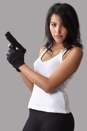 asian woman wearing white vest and holding a gun on her hand