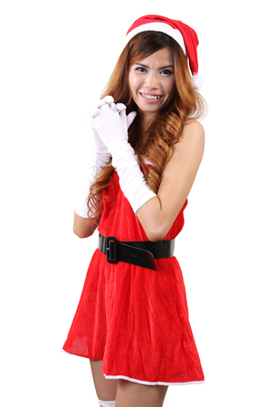 Image of asian woman wearing santa claus clothes and red hat  on white background
