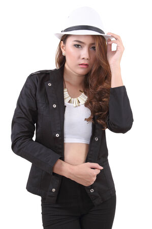 Asian young woman posing her black suit in studio on white background
