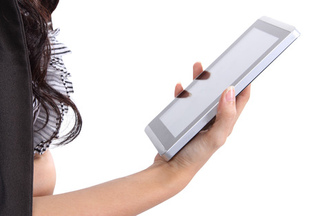 Closeup image of asian woman holding tablet in her hand on white background Stock Photo