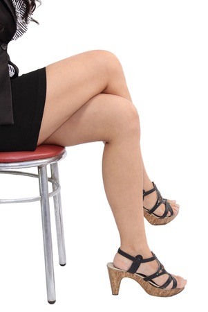 Image of asian business woman legs sitting on chair and white background Stock Photo