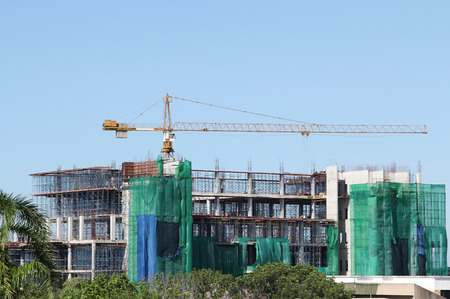 Image of tower crane working construct building Stock Photo