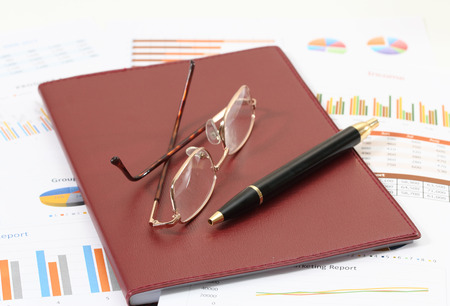 image of financial report and graphics for business photo