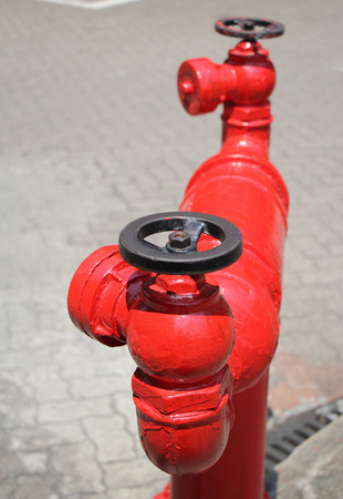 closeup image of red fire hydrant on the street