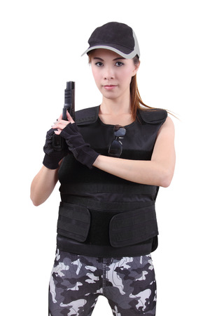 bulletproof vest: asian woman wearing bulletproof vest and holding a gun on her hand