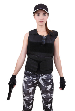 asian woman wearing bulletproof vest and holding a gun on her hand