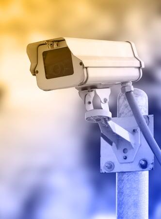 Closeup image of CCTV security camera outdoor at garden photo