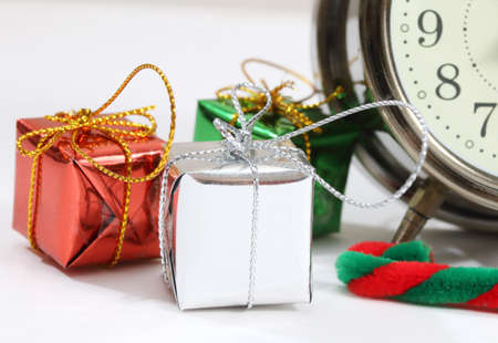 closeup image of little gift box and clock Stock Photo