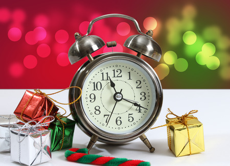 closeup image of little gift box and clock with bokeh background