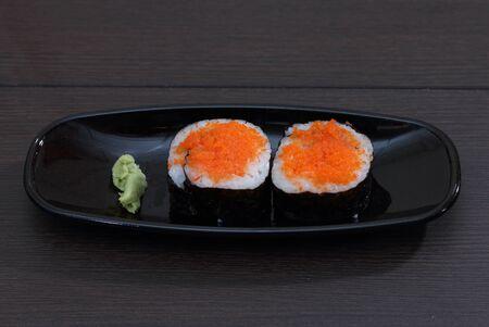 image of japanese food sushi with wasabi on black plate Stock Photo