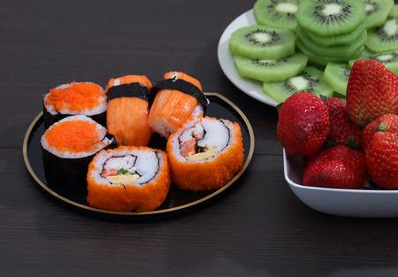 image of japanese food sushi with strawberry and kiwi on table