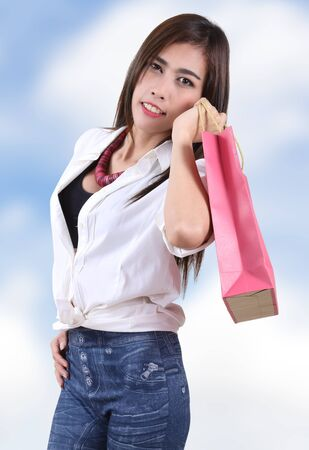 beautiful asian woman holding shopping bag on her hand Stock Photo