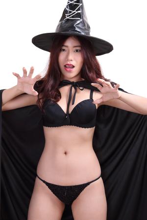 black bikini: portrait young woman witch in black bikini and black hat on white background