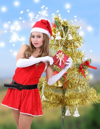 woman wearing santa claus clothes with red hat for christmas season