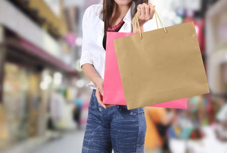 asian woman shopping and holding bag on her hand