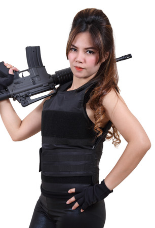 bullet proof: beautiful asian woman in black clothes and bullet proof vest with rifle