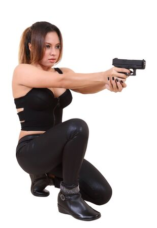 Beautiful asian woman in black clothes and holding her gun