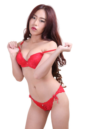 Image of asian woman in sexy red bikini on white background Stock Photo